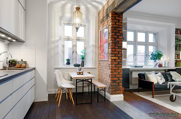 Дизайн гостиной с кирпичной стеной: кирпичная кладка в интерьере зала