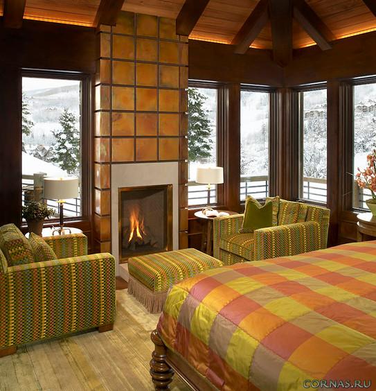 Камин в спальне: комфорт и уют в интерьере.Фото