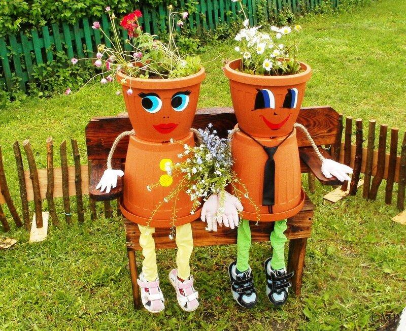 Эмоциональные фигурки из цветочных горшков
